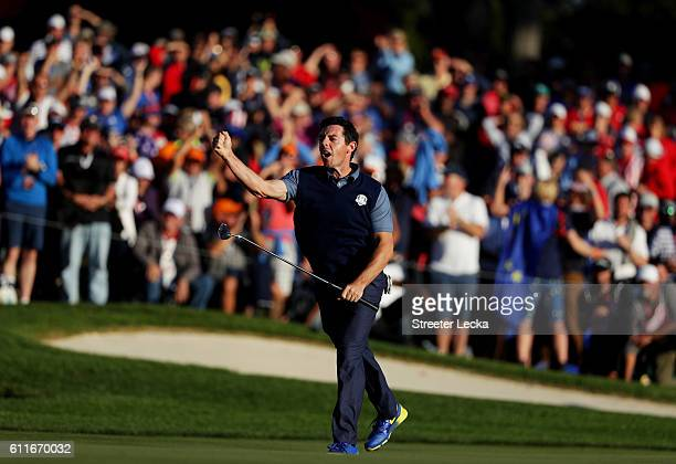 Rory McIlroy of Europe reacts on the 16th green after making a putt to win the match during afternoon fourball matches of the 2016 Ryder Cup at...