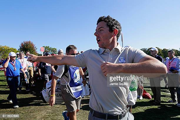 Rory McIlroy of Europe reacts to a member of the crowd while walking to the 12th tee during afternoon fourball matches of the 2016 Ryder Cup at...
