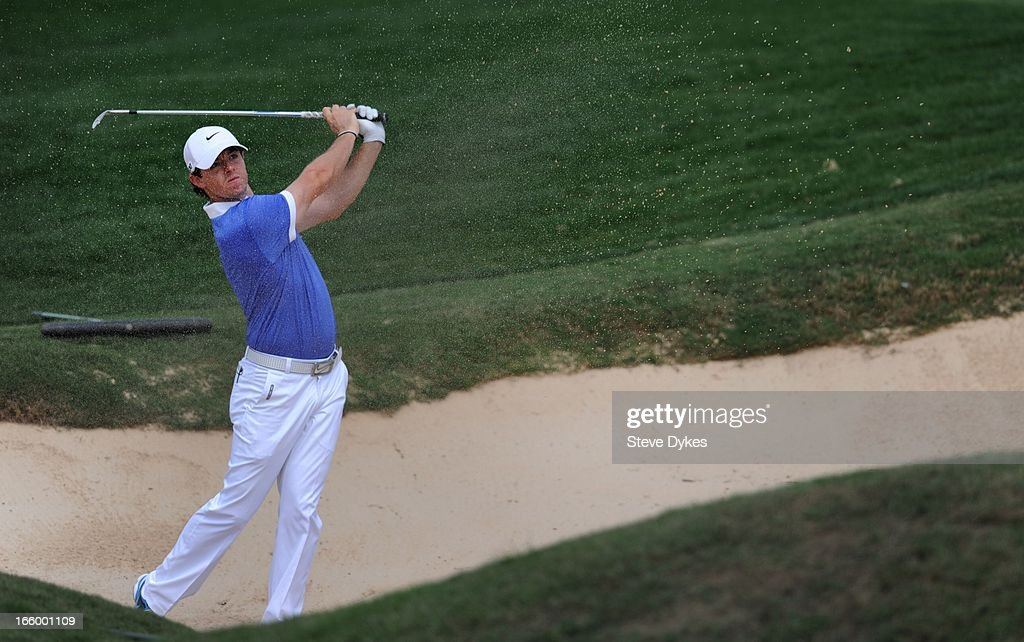 Rory McIlroy of Ireland hits out of the bunker on the 11th hole during the final round of the Valero Texas Open at the AT&T Oaks Course at TPC San Antonio on April 7, 2013 in San Antonio, Texas.