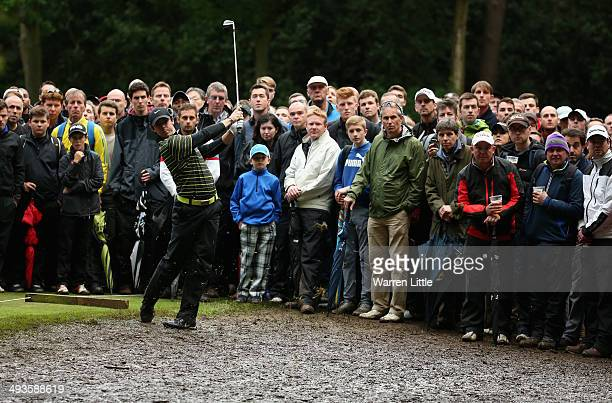 Rory McIlroy of Northern hits his 2nd shot on the 17th hole during day three of the BMW PGA Championship at Wentworth on May 24 2014 in Virginia...