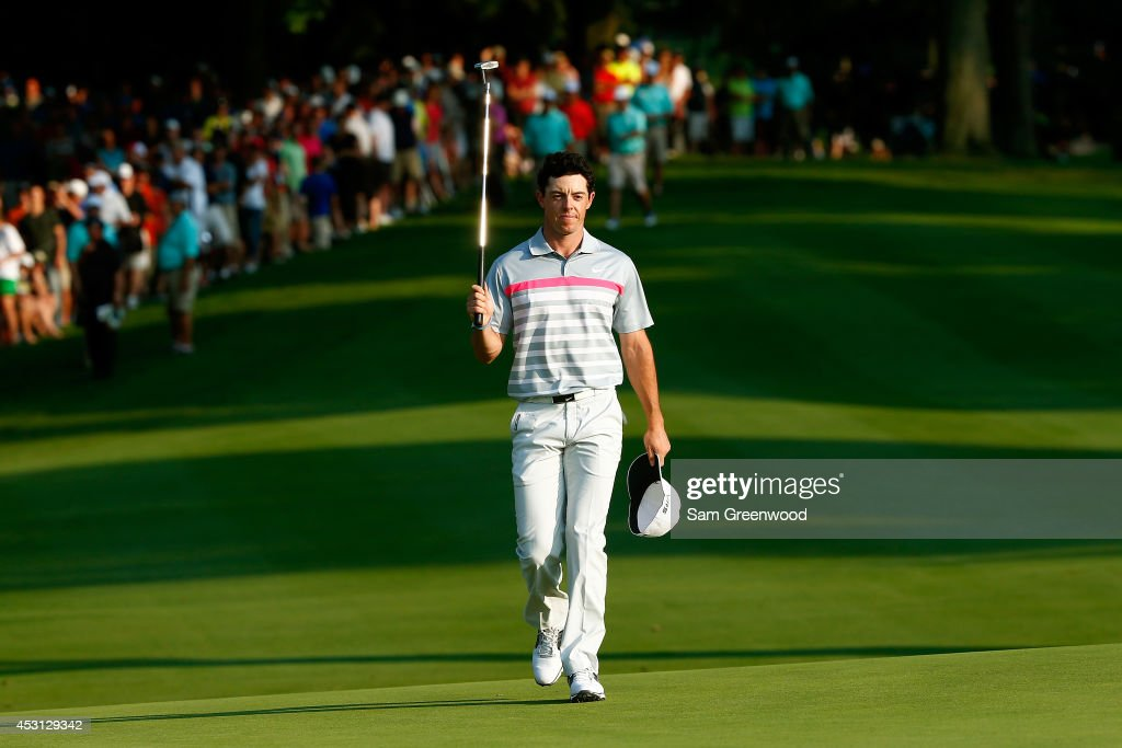 Rory McIlroy of Northern Ireland acknowledges the fans as he walks to the 18th green during the final round of the World Golf Championships-Bridgestone Invitational at Firestone Country Club South Course on August 3, 2014 in Akron, Ohio.