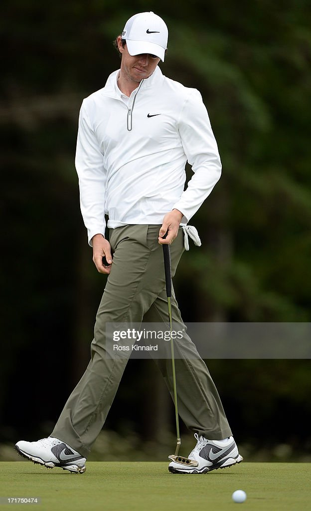 <a gi-track='captionPersonalityLinkClicked' href=/galleries/search?phrase=Rory+McIlroy&family=editorial&specificpeople=783109 ng-click='$event.stopPropagation()'>Rory McIlroy</a> of Northern Ireland after a missed putt on the 14th hole during the second round of the Irish Open at Carton House Golf Club on June 28, 2013 in Maynooth, Ireland.