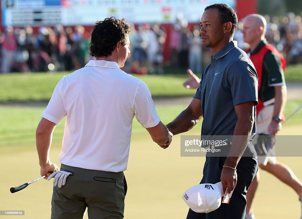 Rory McIlroy of Northern Ireland and and Tiger Woods of the USA shake hands on the 18th hole during the second round of The Abu Dhabi HSBC Golf Championship at Abu Dhabi Golf Club on January 18, 2013 in Abu Dhabi, United Arab Emirates.