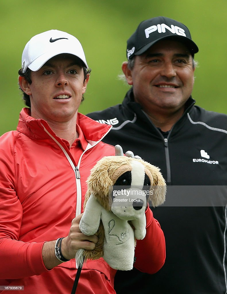 Rory McIlroy of Northern Ireland and Angel Cabrera of Argentina wait to hit on the 11th tee during the first round of the Wells Fargo Championship at...