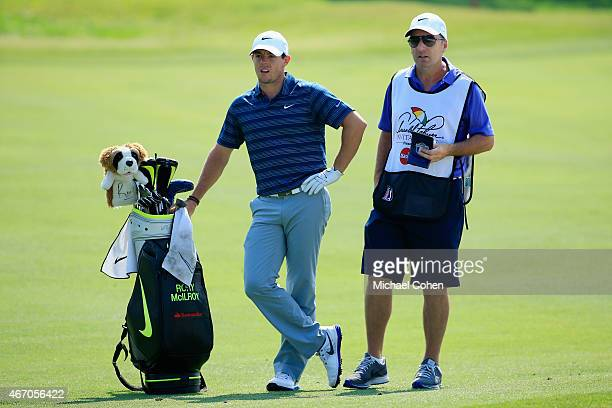 Rory McIlroy of Northern Ireland and caddie JP Fitzgerald wait on the fourth fairway during the second round of the Arnold Palmer Invitational...
