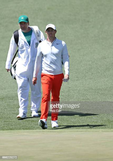 Rory McIlroy of Northern Ireland and caddie JP Fitzgerald walk to the second green during the third round of the 2017 Masters Tournament at Augusta...