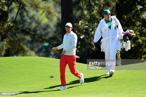 Rory McIlroy of Northern Ireland and caddie JP Fitzgerald walk to the eighth green after playing a chip shot during the third round of the 2017...