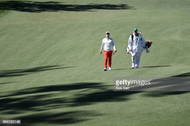 Rory McIlroy of Northern Ireland and caddie JP Fitzgerald walks to tenth green during the third round of the 2017 Masters Tournament at Augusta...