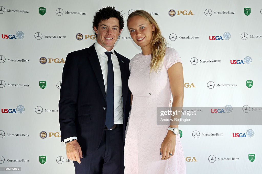 Rory McIlroy of Northern Ireland and <a gi-track='captionPersonalityLinkClicked' href=/galleries/search?phrase=Caroline+Wozniacki&family=editorial&specificpeople=740679 ng-click='$event.stopPropagation()'>Caroline Wozniacki</a> of Denmark attend the US Golf Writers Dinner on April 10, 2013 in Augusta, Georgia.