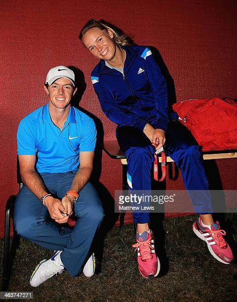 Rory McIlroy of Northern Ireland and Caroline Wozniacki of Denmark pose for a photograph after the final round of the Abu Dhabi HSBC Golf...