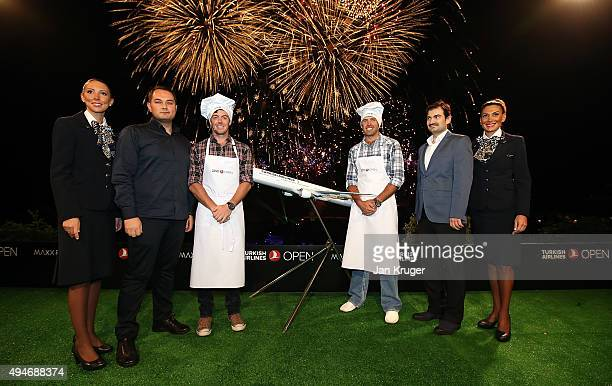 Rory McIlroy of Northern Ireland and Charl Schwartzel of South Africa pose with Turkish Airlines Vice President Sales R Alper Ozen Turkish Airlines...