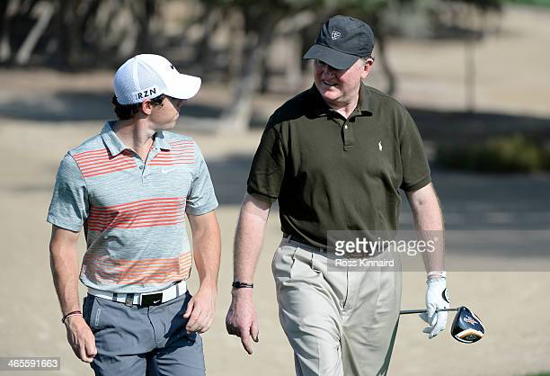 Rory McIlroy of Northern Ireland and Eamonn Darcy of Ireland on the 14th hole during the Champions Challenge prior to the Omega Dubai Desert Classic...