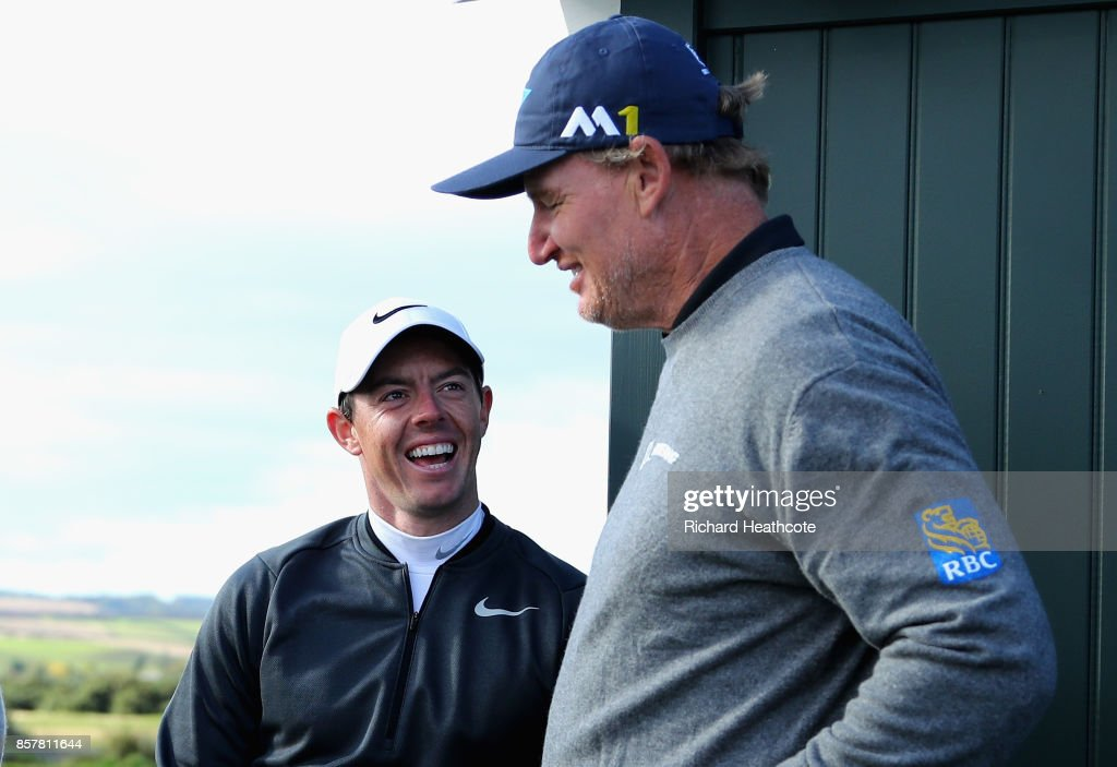 Rory McIlroy of Northern Ireland and Ernie Els of South Africa share a joke whilst they wait on a tee box during day one of the 2017 Alfred Dunhill Championship at The Old Course on October 5, 2017 in St Andrews, Scotland.