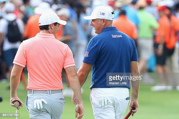 Rory McIlroy of Northern Ireland and Graeme Storm of England walk off the 18th green after the second play off hole during the final round of the BMW...