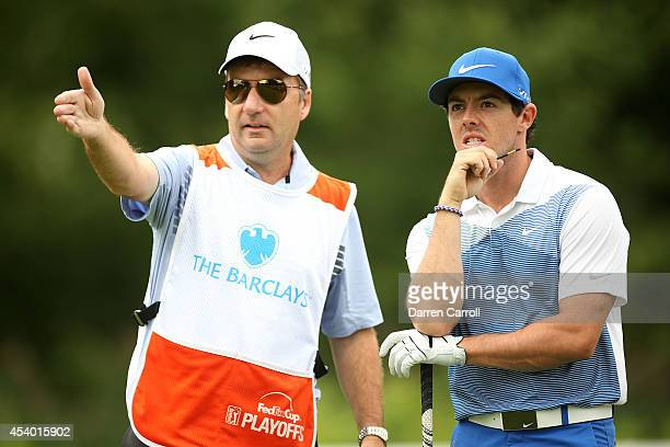 Rory McIlroy of Northern Ireland and his caddie JP Fitzgerald prepare for his shot from the fifth tee during the third round of The Barclays at The...