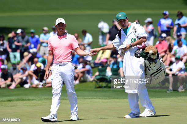 Rory McIlroy of Northern Ireland and JP Fitzgerald stand on the second green during the final round of the 2017 Masters Tournament at Augusta...