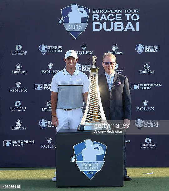Rory McIlroy of Northern Ireland and Keith Pelley Chief Executive of The European Tour pose with the Race To Dubai trophy following the final round...