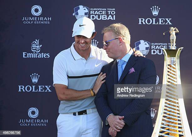Rory McIlroy of Northern Ireland and Keith Pelley Chief Executive of The European Tour are pictured together with the Race To Dubai trophy following...