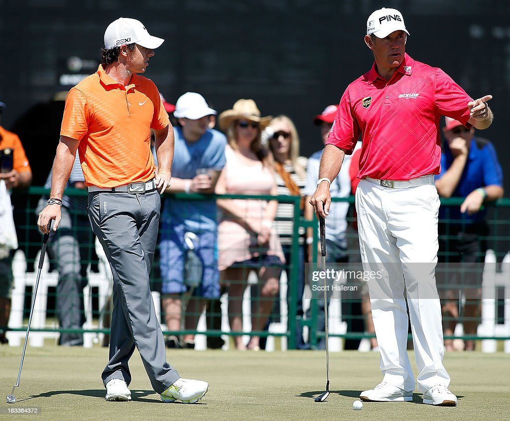 Rory McIlroy of Northern Ireland (L) and Lee Westwood of England chat on the practice green during the second round of the World Golf Championships-Cadillac Championship at the Trump Doral Golf Resort & Spa on March 8, 2013 in Doral, Florida.