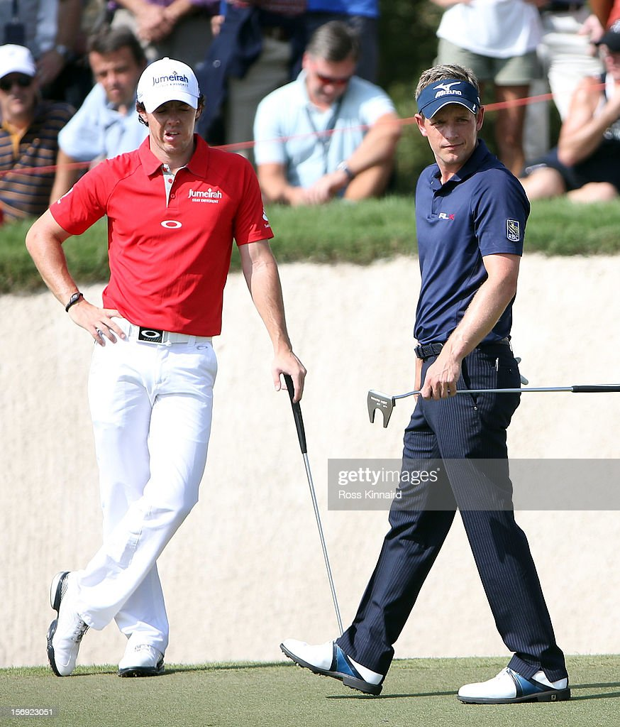 Rory McIlroy of Northern Ireland and Luke Donald of England during the final round the DP World Tour Championship on the Earth Course at Jumeirah Golf Estates on November 25, 2012 in Dubai, United Arab Emirates.