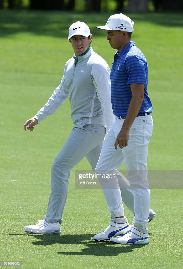 Rory McIlroy of Northern Ireland and (R) Rickie Fowler walk down the eighth fairway during the second round of the Wells Fargo Championship at Quail Hollow Club on May 6, 2016 in Charlotte, North Carolina.