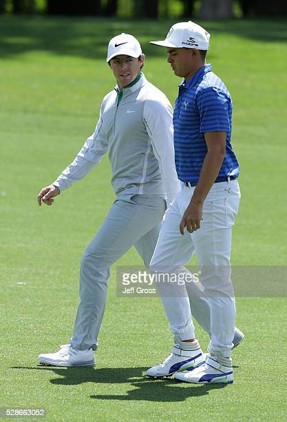 Rory McIlroy of Northern Ireland and Rickie Fowler walk down the eighth fairway during the second round of the Wells Fargo Championship at Quail...