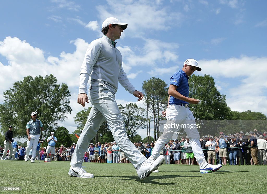 Rory McIlroy of Northern Ireland and (R) Rickie Fowler walk off the eighth tee during the second round of the Wells Fargo Championship at Quail Hollow Club on May 6, 2016 in Charlotte, North Carolina.