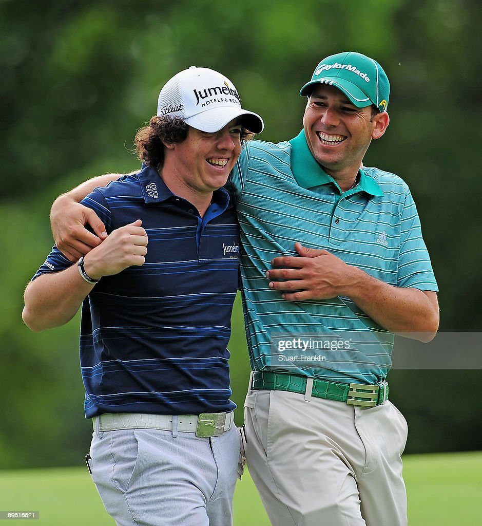 Rory McIlroy of Northern Ireland and Sergio Garcia of Spain enjoy themselves during a practice round of the World Golf Championship Bridgestone Invitational on August 5, 2009 at Firestone Country Club in Akron, Ohio.