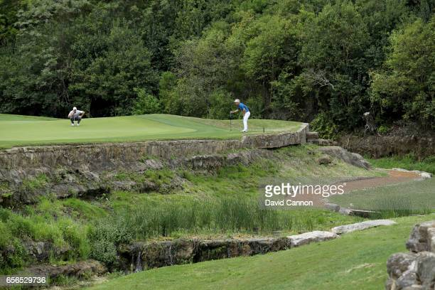 Rory McIlroy of Northern Ireland and Soren Kjeldsen of Denmark on the green at the third hole in their match during the first round of the 2017 Dell...