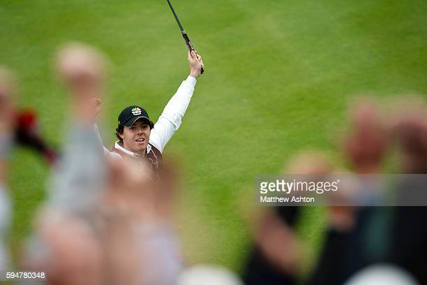 Rory Mcilroy of Northern Ireland and the European Ryder Cup team celebrates sinking the winning putt on hole 17