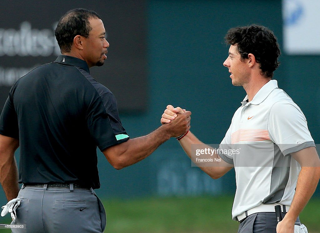 <a gi-track='captionPersonalityLinkClicked' href=/galleries/search?phrase=Rory+McIlroy&family=editorial&specificpeople=783109 ng-click='$event.stopPropagation()'>Rory McIlroy</a> of Northern Ireland and <a gi-track='captionPersonalityLinkClicked' href=/galleries/search?phrase=Tiger+Woods&family=editorial&specificpeople=157537 ng-click='$event.stopPropagation()'>Tiger Woods</a> of the USA shake hands on the 18th greenduring the second round of the 2014 Omega Dubai Desert Classic on the Majlis Course at the Emirates Golf Club on January 31, 2014 in Dubai, United Arab Emirates. .