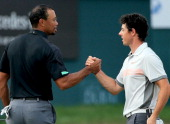 Rory McIlroy of Northern Ireland and Tiger Woods of the USA shake hands on the 18th greenduring the second round of the 2014 Omega Dubai Desert...