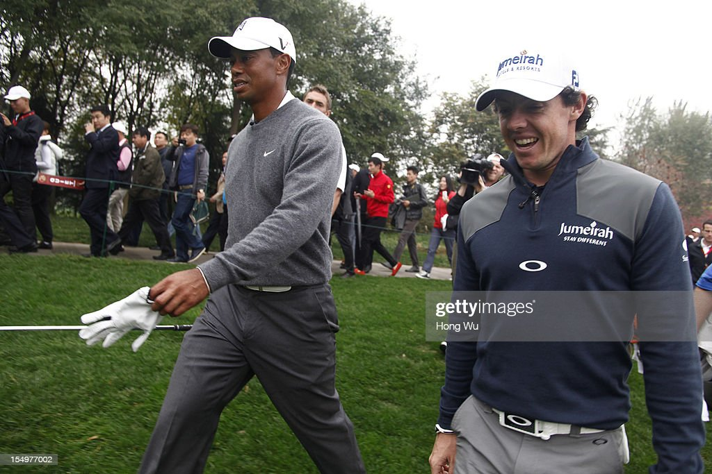 <a gi-track='captionPersonalityLinkClicked' href=/galleries/search?phrase=Rory+McIlroy&family=editorial&specificpeople=783109 ng-click='$event.stopPropagation()'>Rory McIlroy</a> of Northern Ireland (R) and <a gi-track='captionPersonalityLinkClicked' href=/galleries/search?phrase=Tiger+Woods&family=editorial&specificpeople=157537 ng-click='$event.stopPropagation()'>Tiger Woods</a> of USA walk together during the Duel of <a gi-track='captionPersonalityLinkClicked' href=/galleries/search?phrase=Tiger+Woods&family=editorial&specificpeople=157537 ng-click='$event.stopPropagation()'>Tiger Woods</a> and <a gi-track='captionPersonalityLinkClicked' href=/galleries/search?phrase=Rory+McIlroy&family=editorial&specificpeople=783109 ng-click='$event.stopPropagation()'>Rory McIlroy</a> at Jinsha Lake Golf Club on October 29, 2012 in Zhengzhou, China.