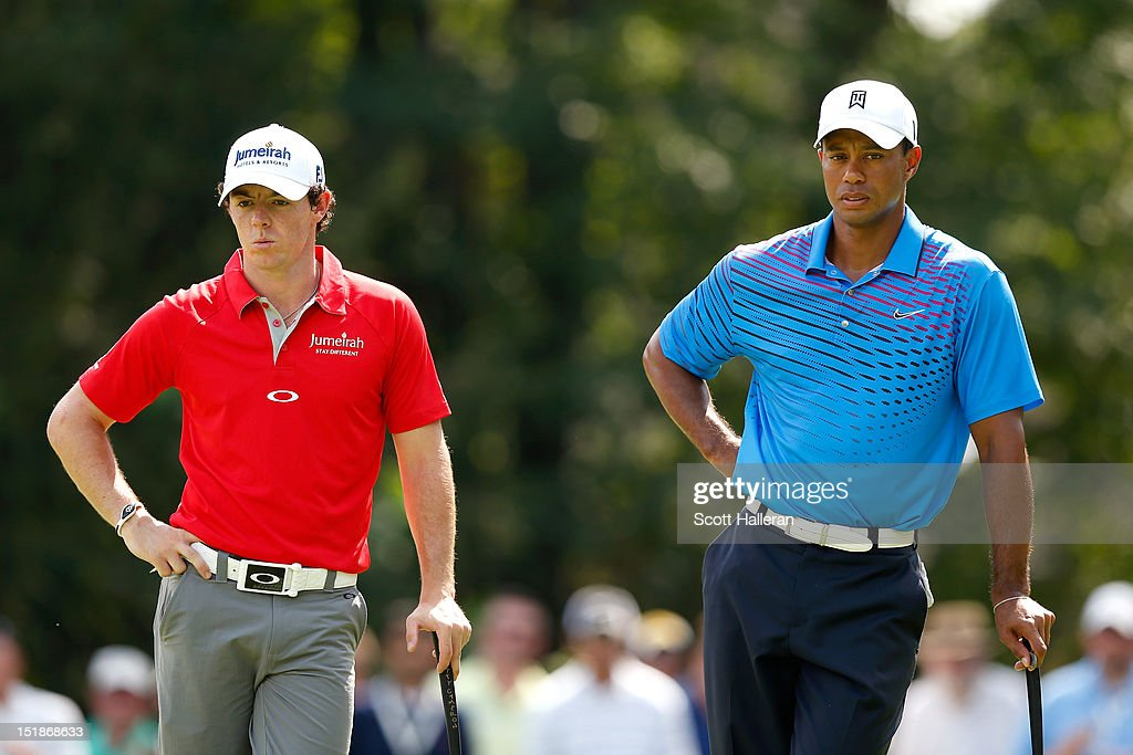 <a gi-track='captionPersonalityLinkClicked' href=/galleries/search?phrase=Rory+McIlroy&family=editorial&specificpeople=783109 ng-click='$event.stopPropagation()'>Rory McIlroy</a> of Northern Ireland and <a gi-track='captionPersonalityLinkClicked' href=/galleries/search?phrase=Tiger+Woods&family=editorial&specificpeople=157537 ng-click='$event.stopPropagation()'>Tiger Woods</a> wait on the fourth green during the first round of the BMW Championship at Crooked Stick Golf Club on September 6, 2012 in Carmel, Indiana.