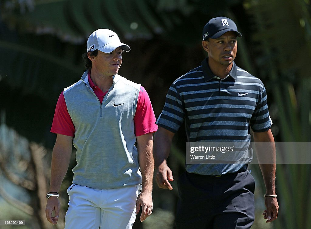 Rory McIlroy of Northern Ireland (L) and Tiger Woods walk onto the 13th hole during the first round of the WGC-Cadillac Championship at the Trump Doral Golf Resort & Spa in Miami, Florida.