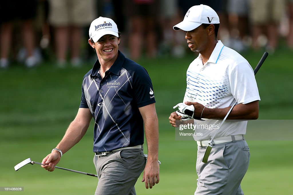 <a gi-track='captionPersonalityLinkClicked' href=/galleries/search?phrase=Rory+McIlroy&family=editorial&specificpeople=783109 ng-click='$event.stopPropagation()'>Rory McIlroy</a> of Northern Ireland and <a gi-track='captionPersonalityLinkClicked' href=/galleries/search?phrase=Tiger+Woods&family=editorial&specificpeople=157537 ng-click='$event.stopPropagation()'>Tiger Woods</a> walk up the second hole fairway during the second round of the BMW Championship at Crooked Stick Golf Club on September 7, 2012 in Carmel, Indiana.