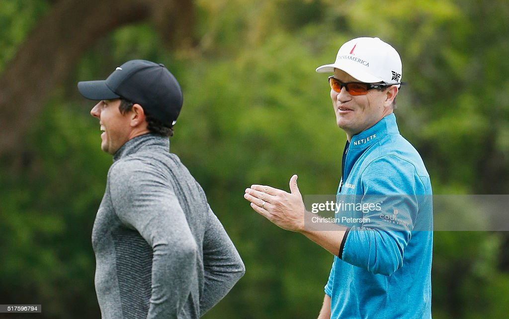 Rory McIlroy of Northern Ireland and Zach Johnson of the United States walk together off a tee box during the round of 16 in the World Golf...