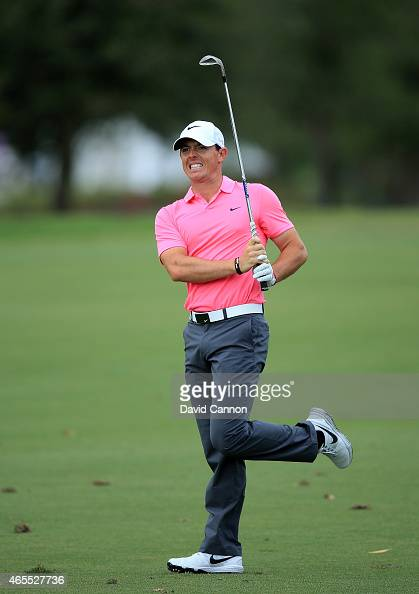 Rory McIlroy of Northern Ireland anxiously follows his second shot on the par 4 17th hole during the third round of the World Golf...