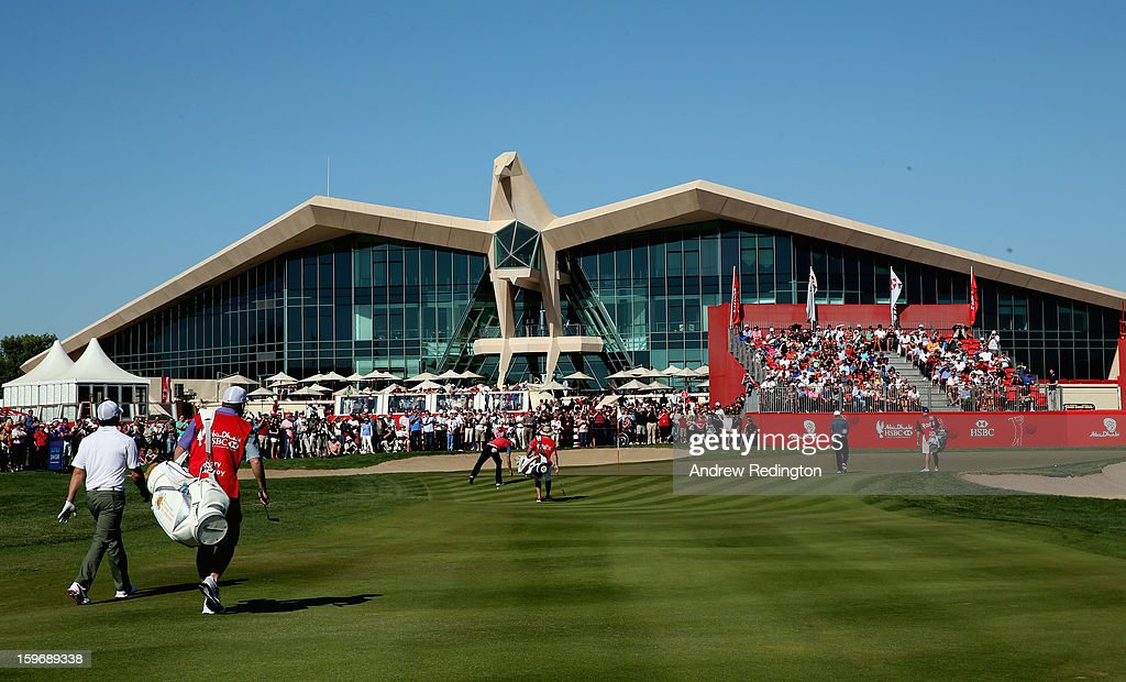 Rory McIlroy of Northern Ireland (left) approaches the 9th green during the second round of The Abu Dhabi HSBC Golf Championship at Abu Dhabi Golf Club on January 18, 2013 in Abu Dhabi, United Arab Emirates.