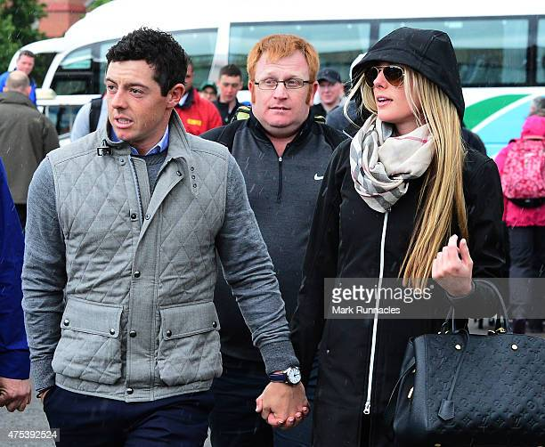 Rory McIlroy of Northern Ireland arrives at the course with new girlfriend Erica Stoll during the fourth round of the Dubai Duty Free Irish Open...