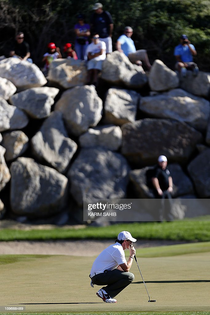 Rory McIlroy of Northern Ireland assesses the green during the second round of the Abu Dhabi Golf Championship at the Abu Dhabi Golf Club in the Emirati capital on January 18, 2013. AFP PHOTO/KARIM SAHIB
