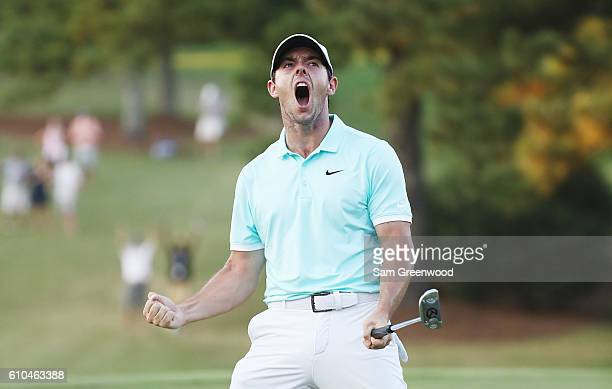Rory McIlroy of Northern Ireland celebrates a birdie putt to defeat Ryan Moore on the fourth playoff hole to win the TOUR Championship and clinch the...
