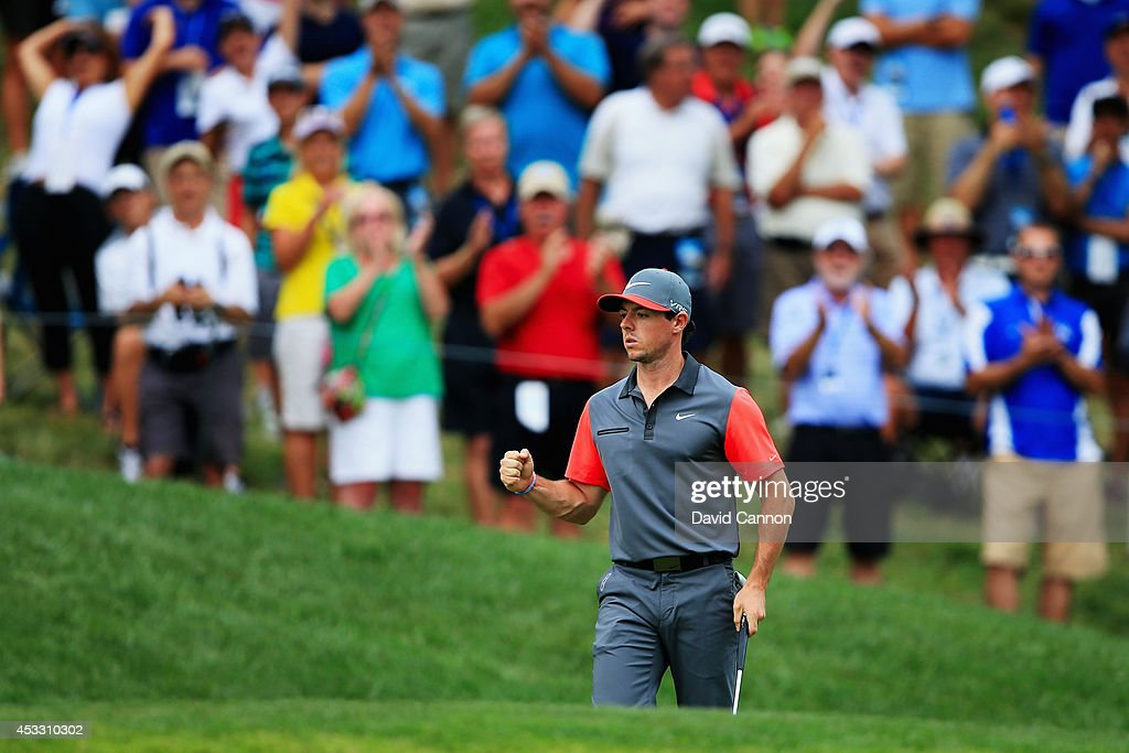 Rory McIlroy of Northern Ireland celebrates a putt for birdie on the 14th hole during the first round of the 96th PGA Championship at Valhalla Golf Club on August 7, 2014 in Louisville, Kentucky.