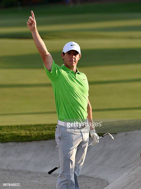 Rory McIlroy of Northern Ireland celebrates after he holes out from the bunker on 18 green during the first round of the DP World Tour Championship...