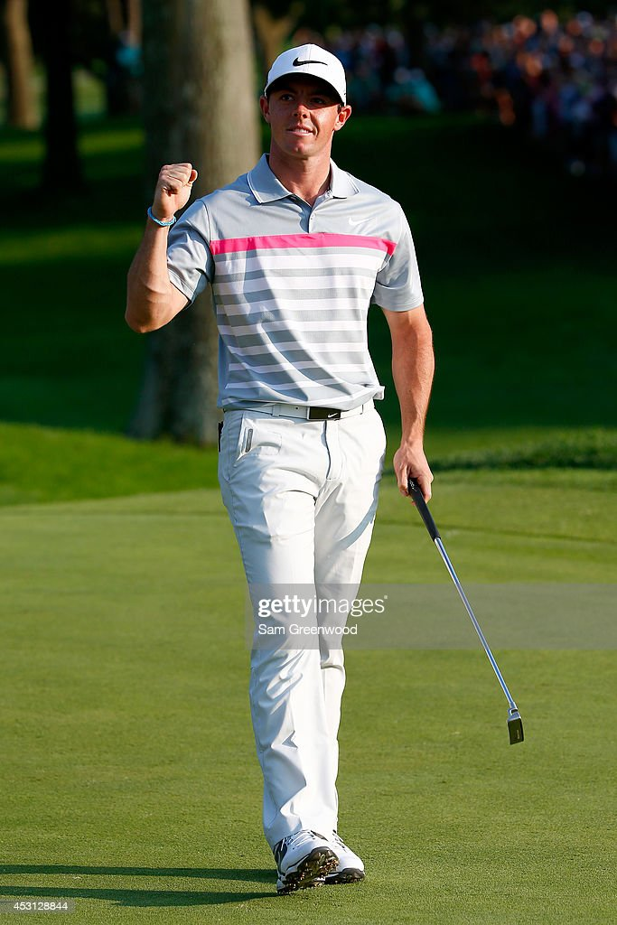 Rory McIlroy of Northern Ireland celebrates after his winning putt on the 18th green during the final round of the World Golf Championships-Bridgestone Invitational at Firestone Country Club South Course on August 3, 2014 in Akron, Ohio.