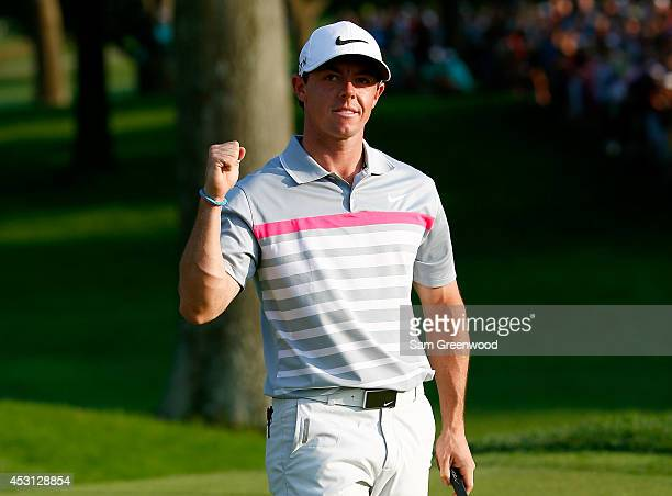 Rory McIlroy of Northern Ireland celebrates after his winning putt on the 18th green during the final round of the World Golf...