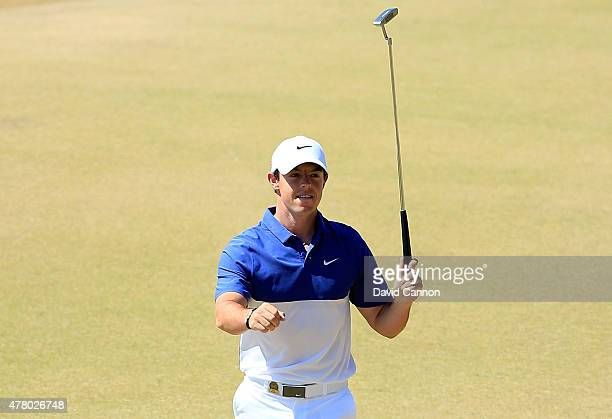 Rory McIlroy of Northern Ireland celebrates after holing a long birdie putt on the 13th green during the final round of the 115th US Open...