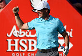 Rory McIlroy of Northern Ireland celebrates his 'holeinone' on the par three 15th hole during the second round of the Abu Dhabi HSBC Golf...