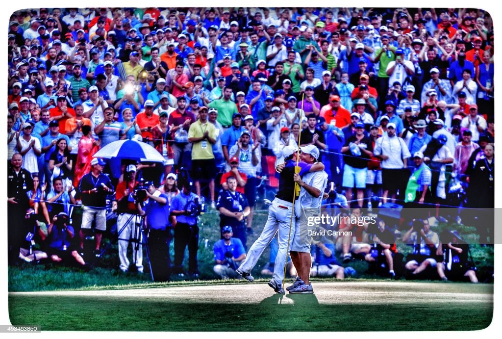 Rory McIlroy of Northern Ireland celebrates his onestroke victory on the 18th green with his caddie JP Fitzgerald during the final round of the 96th...