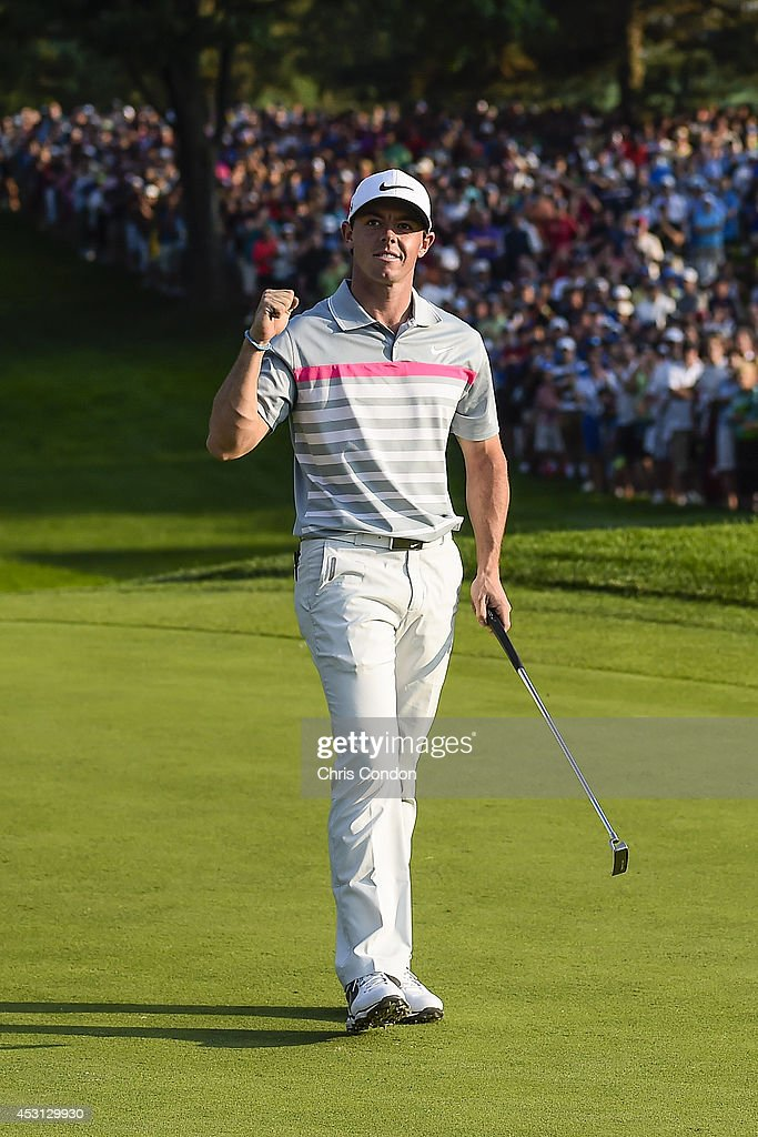 <a gi-track='captionPersonalityLinkClicked' href=/galleries/search?phrase=Rory+McIlroy&family=editorial&specificpeople=783109 ng-click='$event.stopPropagation()'>Rory McIlroy</a> of Northern Ireland celebrates his two stroke victory against Sergio Garcia of Spain on the 18th hole green during the final round of the World Golf Championships-Bridgestone Invitational at Firestone Country Club on August 3, 2014 in Akron, Ohio.